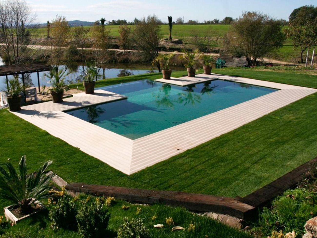 Construcci n de piscina desbordante en c ceres naturclara for Piscinas cubiertas alcobendas